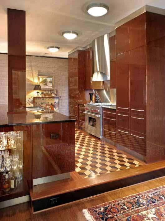 Una cocina conectada al living de la casa de manera uniforme