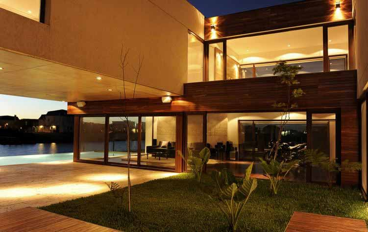 Una hermosa casa en nordelta muestra su dise o interior for Casas modernas nordelta